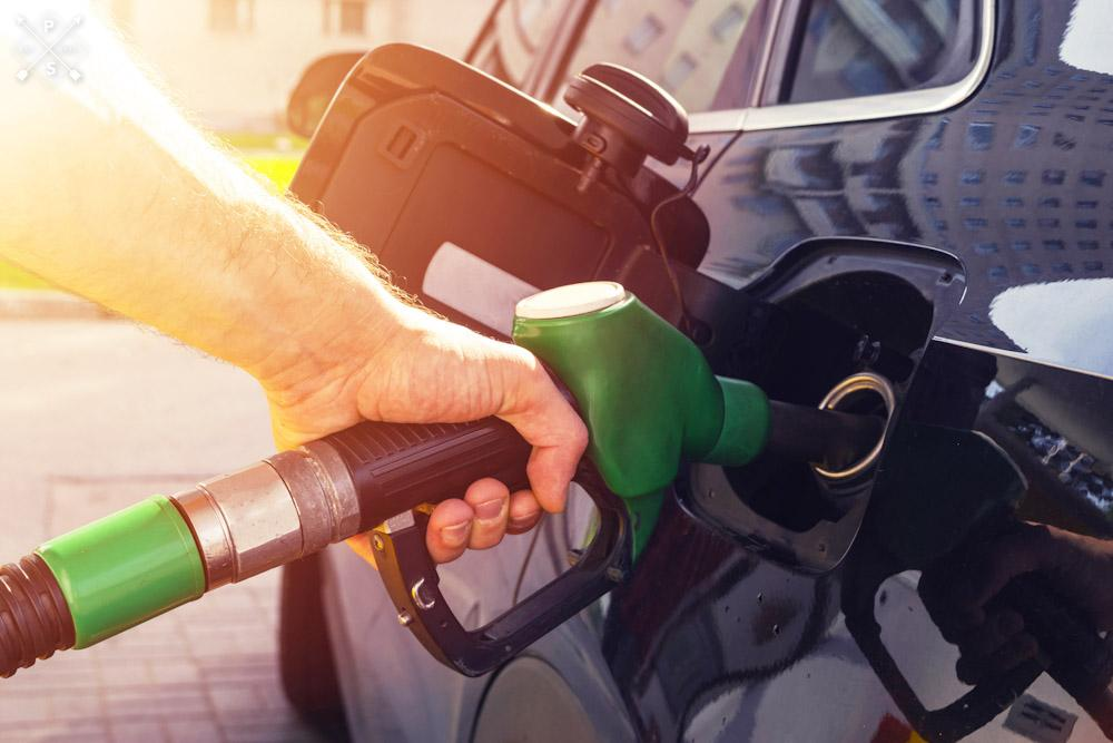 Person fueling up vehicle